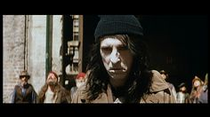 """Screen capture of Alice Cooper as """"Street Schizo"""" from the John Carpenter film, Prince of Darkness (1987)."""