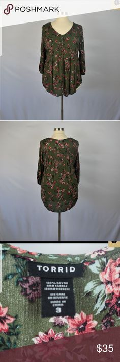 320b5b85c8625 Torrid Smocked Sleeve Blouse Relaxed fit Floral print Color is dark olive  green sleeve with rouching Button down Chest 27 Length 31 torrid Tops  Blouses