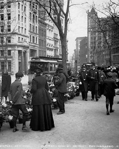 An American Gilded Age street scene, c.1904. Uniformed policemen and pedestrians, walking past a flower vendor display, in NYC. Detroit Publishing Company photographers ~ {cwlyons} ~ (Original Image: NYPL)