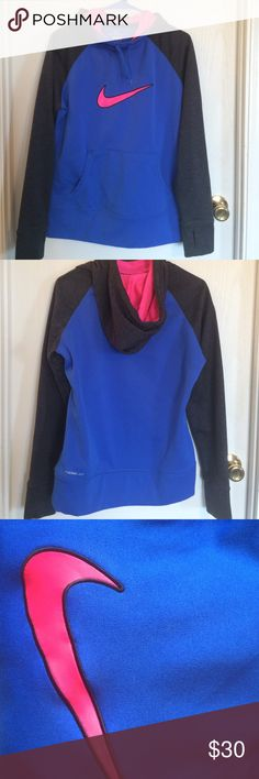 Nike Therma-fit hoodie ❤️Price Drop Like new Nike Hoodie. Size M therma-fit soft hoodie. Blue body with dark gray (black) arms and hood. Neon hot pink inside hood and Nike swoosh. Worn a few times and in excellent condition. Nike Tops Sweatshirts & Hoodies
