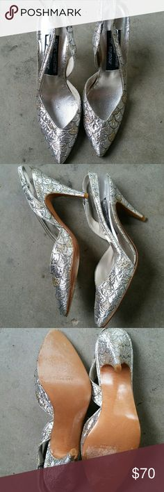 VTG Gold & Silver Stuart Weitzman Heels!♡ These shoes are so gorgeous! I wish they'd fit me!:( They're silver and gold with a pull over heel strap (non adjustable) coming apart a tad bit but easy fix! See through part on outer shoe. 4in heel. Made in Spain genuine leather. Beautiful. Says 7.5 but they're definitely a 6.5-7! Very very narrow shoes made for small petite feet!♡ Stuart Weitzman Shoes Heels