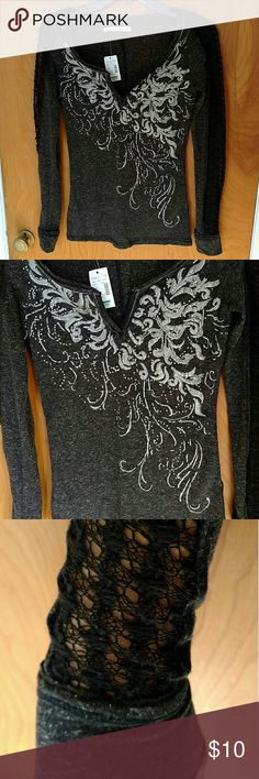 Maurice's Grey, Embellished, Long-Sleeve Top Beautiful, dark heather grey top with black lace down the arms, silver stitching, and silver and clear embellishments. Extremely cute addition to any closet. Selling because I bought it without trying it on and it is too small. There are a couple places where the black lace has started to unravel (pictured below). Looks like it could be mended in a few minutes. Maurices Tops Tees - Long Sleeve