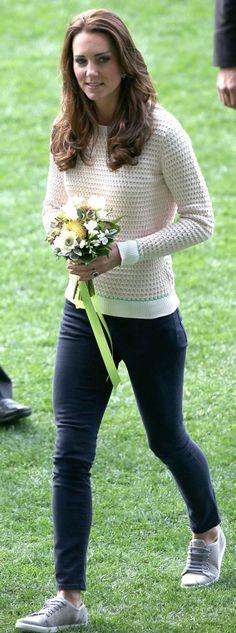 Kate Middleton.  Sweater – Jonathan Saunders.   Shoes – Mint Velvet. http://outfitidentifier.com/kate-middleton/who-made-kate-middletons-white-sweater-and-gray-tennis-shoes/
