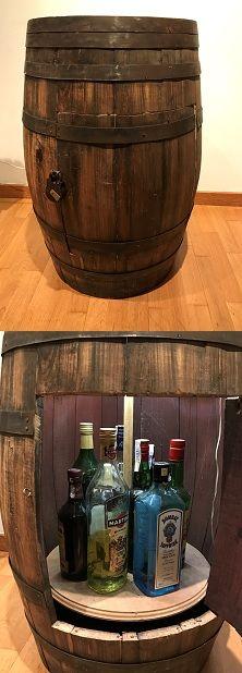 Barrica de vino aprovechada para crear un botellero para licores. Con plataforma giratoria y tiras de luz led en el interior. La bisagra de la puerta esta echa con un eje en el lateral, para evitar ver nada.