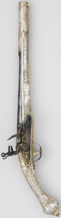 Ottoman (Balkan?) flintlock pistol, 18th century, lock and barrel European (probably French), steel, silver, gold, L. 20 1/2 in. (57.1 cm); L. of barrel 13 1/2 in. (34.3 cm); L. of lock 4 5/8 in. (11.8 cm); Cal. .65 in. (16.5 mm); Wt. 2 lbs 12 oz. (1304.1 g), Met Museum.