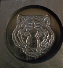 Round graphite mold with tiger face design from raw metalz