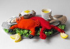 Lobster Crab Seafood Felt Food Pattern PDF, includes instructions for lobster, crab, oysters, clams, melted butter cup, baked potato, lemon slices, lettuce leaf garnish, platter, kid sized lobster bib