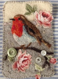 (c) Lou Tonkin cute way to hide little holes in your favourite woollen coats and cardigans is to use the new trend of art darning , embellishment and needle felting designs over the area like this beautiful robin and rose design perfect patch for your lovely folk fairy , woodland elf , or fairytale inspired victorian fashion wardrobe , or just make it for wall art in your gypsy inspired interiors