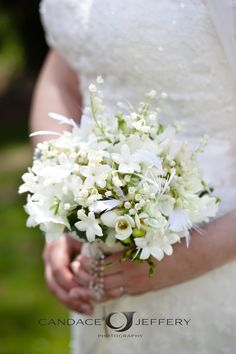 Stephanotis, lily of the valley, freesia, feathers