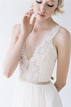 Bride in ballerina inspired wedding dress with a plunging lace neckline @myweddingdotcom