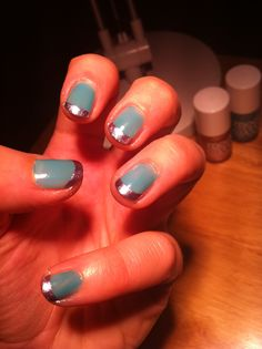 Top Turquoise with metallic tipped Nails