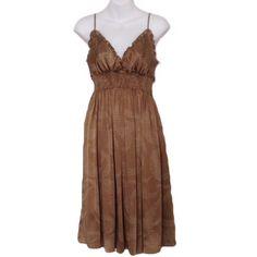 BCBG MaxAzria Woven Silk Dress NWT! BCBG MaxAzria Woven Silk Dress -Color: Dark Camel -Pull on style -Adjustable spaghetti straps -Smocked waistband -100% Silk BCBGMaxAzria Dresses