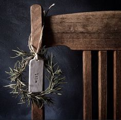 Old wooden chair and tiny rosemary wreath. Great rustic holidays decor idea!
