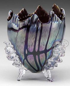 "Pallme-Konig, Footed Rose Bowl iridescent bowl has a pulled-hankerchief top and is accented with deep purple threads of glass.  The bowl is supported by three frosted Iridescent glass feet of  sea anemone form.  SIZE: 5"" t"
