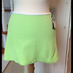 Cute Sport Skirt This lime skirt with white trim is NWT--so cute! Very soft, made from 90% nylon, 10% Lycra. Lots of stretch! Ralph Lauren Skirts Mini
