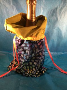 A personal favorite from my Etsy shop https://www.etsy.com/listing/399035039/wine-bag-rainbow-petalyellow