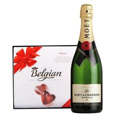 Moet & Chandon the Imperial's flagship style has an exotic fruitiness that will delight and seduce those lucky enough to experience this magical drink.  Impress those you love by serving and desserting before dinner.  The gift contains 750ml Moet Chandon champagne and 200 g Belgian candy box.  #ValentinesDay #ValentinesDayGifts #ValentinesDayGiftIdeas #love Moet Chandon, Belgian Chocolate, Corporate Gifts, Valentine Day Gifts, Champagne, Exotic, Candy, Dinner, Drinks
