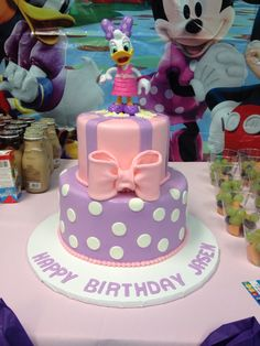 Daisy Duck cake in pink and purple.  Cake by TracyCakesAR.