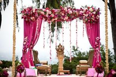 Ami, I was envisioning something like this with the pink fabric and the white/pink flowers with greens. We can do it more in the shape of the other mandap, but do you like these colors?