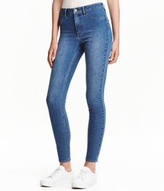 Check this out! Ankle-length jeans in washed stretch denim with a high waist, mock front pockets, regular back pockets, and skinny legs. - Visit hm.com to see more.