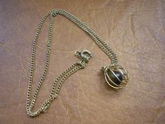 Retro gold tone art deco chain with ball pendant and by badgestuff, $5.00