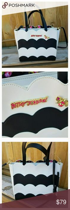 🆕Betsey Johnson bag Adorable black and white scallop design bag that has a top zip closure with open slot pockets on front and back.  Zippered pocket inside and 2 open pockets.  Brand new with tags.  Comes with crossbody strap.  12x11.  Crossbody strap is adjustable with the drop average around 23 inches Betsey Johnson Bags