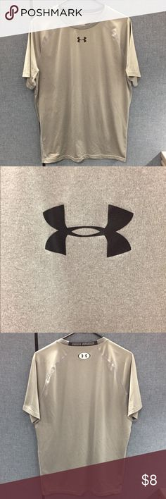 Under Armour Comprehension Dry Gear T-shirt Under Armour Comprehension Dry Gear T-shirt  Shirt is in good condition except the back logo is cracked as seen in picture. Under Armour Shirts Tees - Short Sleeve