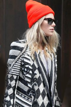 In Paris, Dree Hemingway tops off a monochrome print blazer with a bright orange beanie . Details In Streetstyle