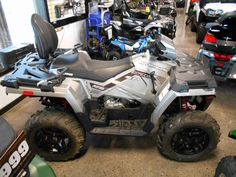 New 2017 Polaris Sportsman® Touring 570 SP ATVs For Sale in Wisconsin. SILVER PEARL Premium SP performance package High-performance close-ratio on-demand All-Wheel Drive (AWD) Engine Braking System (EBS) with Active Descent Control (ADC)