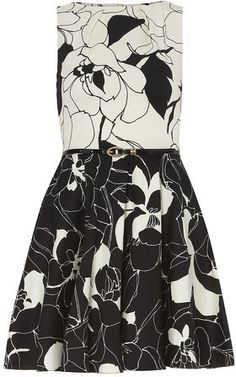 $95, White and Black Floral Skater Dress: Dorothy Perkins Closet Black And White Floral Dress. Sold by Dorothy Perkins. Click for more info: https://lookastic.com/women/shop_items/229002/redirect