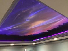 This stunning media room mural was painted on a ceiling by Bryan King of Artifice Inc. using our Wildfire Luminescent Paints and our Invisible Fluorescent Paint. This image is under incandescent and blacklight. The stars and moon slowly reveal themselves during the day.
