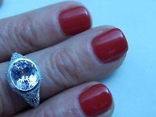 3.90 Ct. Oval Faceted Kunzite Bezel SetSterling Silver Filigree Ring
