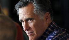 In this March 3, 2018, file photo, Mitt Romney speaks with a group during a breakfast campaign stop in Green River, Utah. (AP Photo/Rick Bowmer, File)