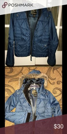 🔥Warm and Toasty🔥 O'Neill winter coat Barely worn, warm and furry, gorgeous jewel toned blue winter coat.  Slightly longer than waist length with furry hood and warm, fleecy wrist cuffs.  Very stylish and the perfect coat for you! O'Neill Jackets & Coats