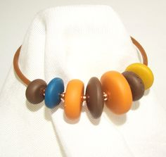 Simple Memory Wire Bracelet with Handmade Stack of Polymer Clay Focal Beads. by MyStudio91 on Etsy