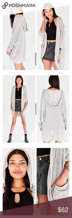 """Urban Outfitters Gray Cocoon Cardigan Sweater Super slouchy hooded cocoon Dallas cardigan sweater from modern essentials label Silence + Noise. In a cozy light sweater-knit with an open, oversized fit detailed with drapey balloon-sleeves, side pouch pockets and an oversized hood. Rayon, polyester. Hand wash. Measurements taken from size Medium. Chest: 34"""". Length: 32"""". Color: gray. Purchased from Urban Outfitters. Other sizes available. Urban Outfitters Sweaters Cardigans"""