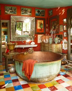 There is so much going on in this room . . . but oh my, that copper tub is amazing.