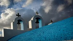 Church in Paros against the March sky