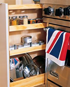 Narrow Cupboard  A narrow pullout cupboard makes efficient use of the 7-inch gap between the stove and an adjacent wall. Although it's slim, it easily holds spice jars and pot lids.