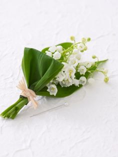 lily of the valley white and green boutonniere for the groom and / or groomsmen #wedding