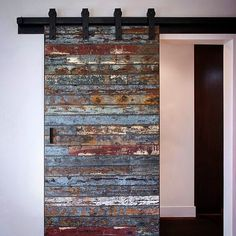 Not your ordinary barn door: Salvaged marine wood from a 40 year old bait barge which was destroyed by a swell in the Pacific Ocean from the 2011 Tsunami that hit Japan. We were lucky to get the remaining pieces to create this one of a kind sliding door! Wooden Sliding Doors, Wood Doors, Entry Doors, Patio Doors, Pine Doors, Wooden Windows, Sliding Barn Door Hardware, Diy Casa, Reclaimed Wood Projects
