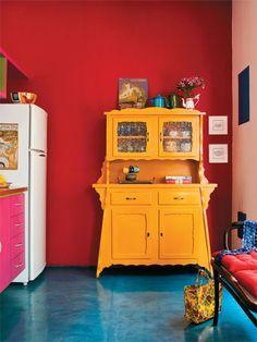 vintage furniture - kitchen  Love the orange kitchen stand.  Makes the kitchen just pop with excitement!