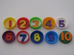 Painting with Homemade Number Stamps using Bottle Tops - great for helping kids learn about numbers