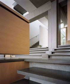 Modern Stairs // concrete stairs w/ wood statement wall at the Shaw House by Patkau Architects - Kindesign British Columbia, Architecture Details, Interior Architecture, Building Architecture, Shaw House, Concrete Stairs, Concrete Slab, Modern Stairs, Vancouver