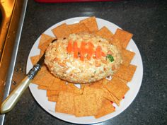 Take your favorite cheese ball recipe of choice and roll it into a football shape for Super Bowl or man parties! I made this one with carrot strips as the laces, but you could use twizzlers or anything really:)