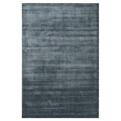 Anchor your living room seating group or define space in the den with this hand-loomed art silk rug, featuring a raised tonal striping for a touch of texture...