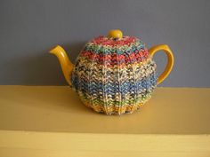 A simple tea cosy which is quick and easy to knit. By using aran instead of double knitting, the same pattern can be used to fit a larger teapot.
