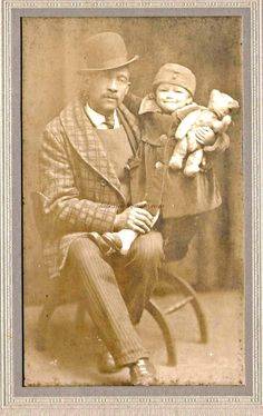 African American man and tot with teddy bear. photo offered for sale at labonnevivante.com--vintage and antique photographs category