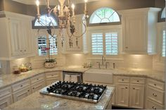 white cabinets, white stone counter, wood floor, gray paint