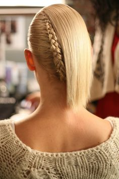alternate to just wearing your short hair down, add a twist. Part hair in half and French braid one half and pin the end under the other half. Alexandre Herchcovitch